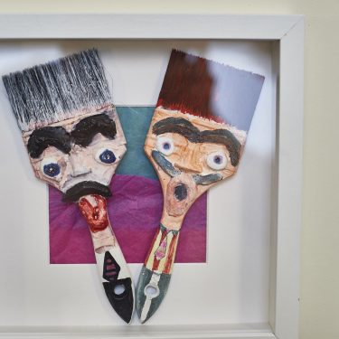Paintbrushes with faces in a frames
